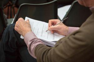 conference-delegate-taking-notes.jpg
