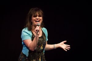 Female-comedian-performing-on-stage.jpg